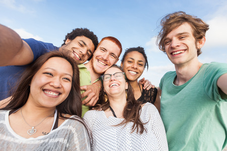 multiethnic: Multiracial Group of Friends Taking Selfie at Beach Stock Photo