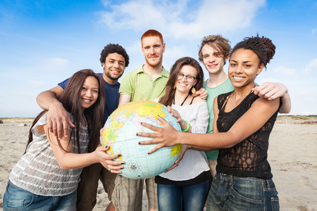 Multiracial Group of Friends with World Globe Map photo