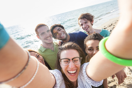 traveller: Multiracial Group of Friends Taking Selfie at Beach Stock Photo