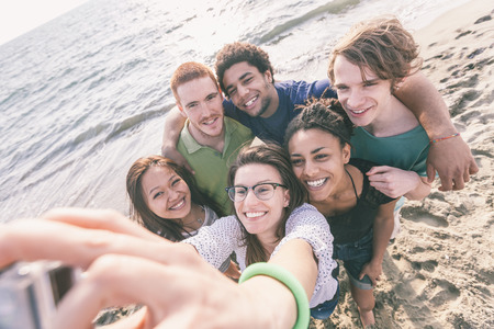 multiracial: Multiracial Group of Friends Taking Selfie at Beach Stock Photo