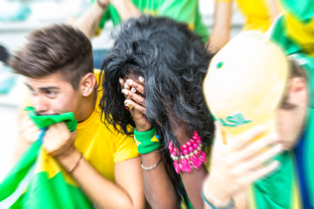 cheering fans: Sad Brazilian Supporters at Stadium
