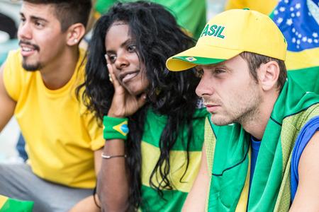 happy crowd: Sad Brazilian Supporters at Stadium