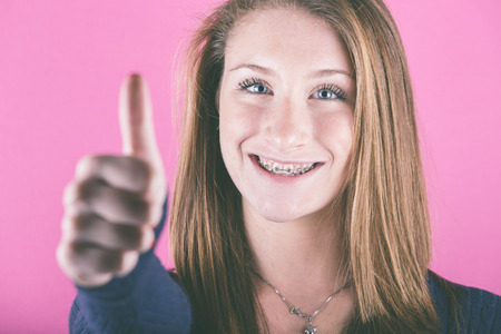 Beautiful Girl with Thumbs Up photo