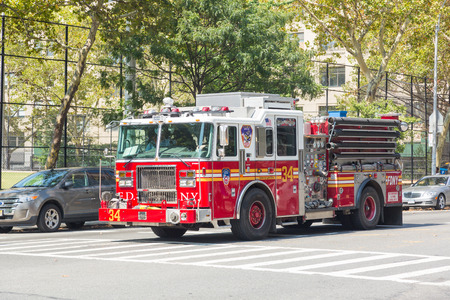 fire truck: NEW YORK, USA - AUGUST 20, 2014: FDNY fire truck on Manhattan 9th Avenue. FDNY provide both Fire and EMS services. Editorial