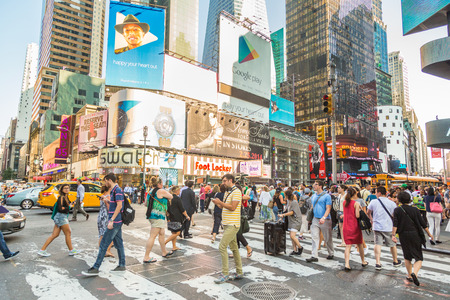 NEW YORK, USA - AUGUST 20, 2014: Times Square crowded of tourists at late afternoon. More than 300 thousand people visit this square every day. Publikacyjne