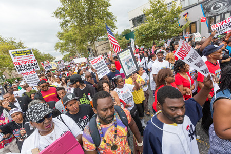 NEW YORK, USA - AUGUST 23, 2014: Thousands march in Staten Island to protest Eric Garner's death by NYPD cops. Editöryel