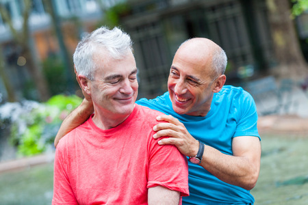 happy senior couple: Gay Couple at Park in New York Stock Photo