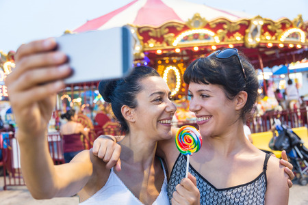 Happy Young Women Taking Selfie at Luna Park photo
