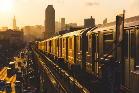 sunset city: Subway Train in New York at Sunset