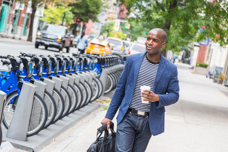 young professionals: Young Man Commuting in New York Stock Photo