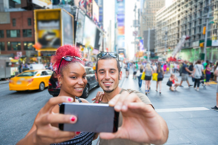 honey moon: Young Couple Taking Selfie in Times Square Stock Photo