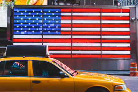 times square: United States Flag and Yellow Cabs