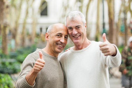 Gay Couple showing Thumbs Up in New York