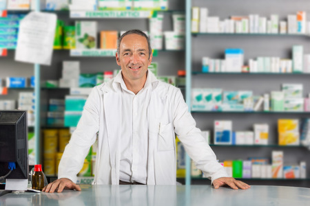 Handsome Pharmacist Portrait in a Drugstore photo