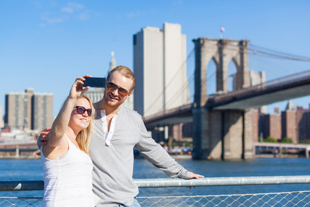 Caucasian Couple Taking Selfie in New York photo