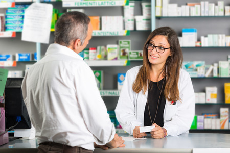 pharmacist: Pharmacist and Client in a Drugstore