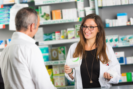 selling service smile: Pharmacist and Client in a Drugstore