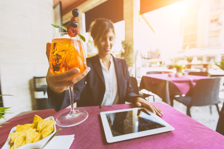 having a break: Young Businesswoman Having a Break at Bar