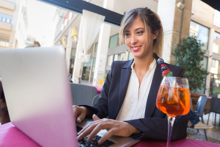 coffee hour: Young Businesswoman with Laptop during a Break