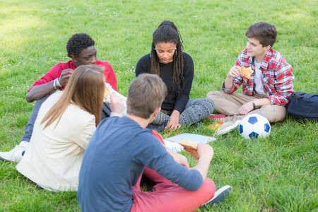 happy teenager: Teen Friends Having a Break at Park