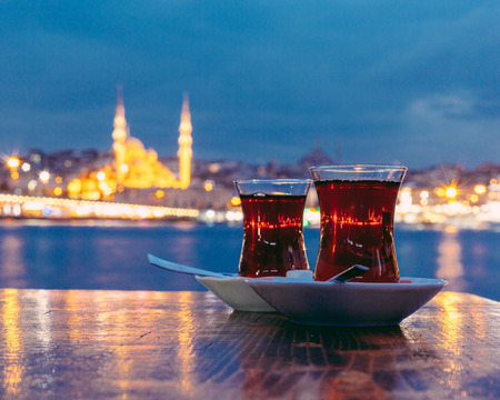 Typical Turkish Tea with Istanbul City on Background 스톡 콘텐츠