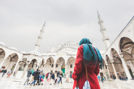 blue mosque: Young Arabian Woman wearing Veil in front of a Mosque