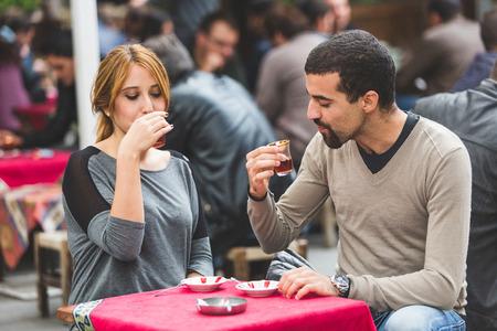 turkish woman: Turkish Couple Drinking Cay, Traditional Tea, in Istanbul