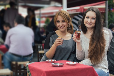 cay: Two Women Drinking Cay, Traditional Turkish Tea, in Istanbul