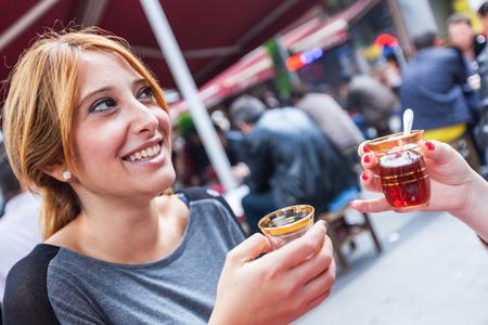 turkish woman: Two Women Drinking Cay, Traditional Turkish Tea, in Istanbul