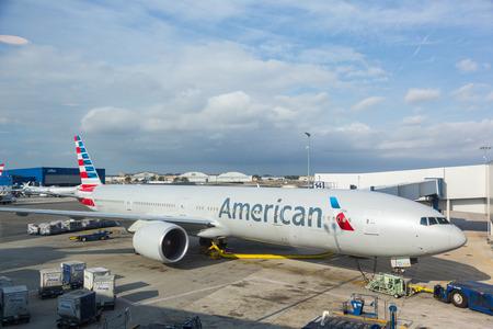 american airlines: NEW YORK, USA - SEPTEMBER 10, 2014: American Airlines Boeing 777 at New York JFK airport before boarding passengers.