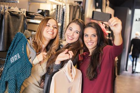 Three Women Taking a Selfie while Shopping