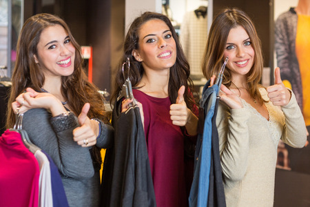 Three Happy Women in a Clothing Store after Shopping