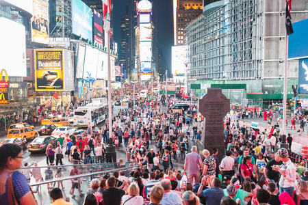 times square: NEW YORK, USA - SEPTEMBER 4, 2014: Times Square crowded of tourists at late afternoon. More than 300 thousand people visit this square every day.