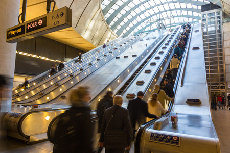 LONDON, UNITED KINGDOM - OCTOBER 30, 2013: Crowded Escalator in Canary Wharf district