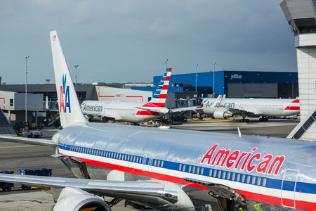 jfk: NEW YORK, USA - SEPTEMBER 10, 2014: American Airlines Boeing 767 at New York JFK airport with some more aircrafts on background
