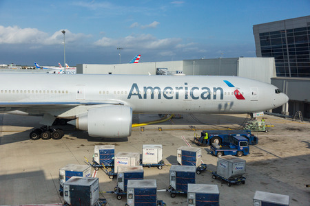 american airlines: NEW YORK, USA - SEPTEMBER 10, 2014: American Airlines Boeing 777 at New York JFK airport before boarding passengers.