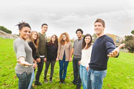 Multiethnic Group of Friends Giving a Hand Stock Photo