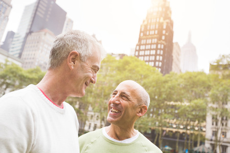 lovers embracing: Gay Couple at Park in New York Stock Photo