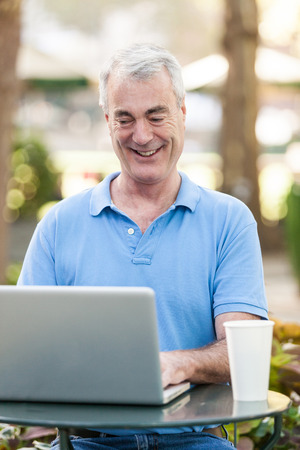 bryant park: American Senior Man with Computer at Park