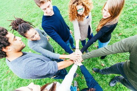 Multiracial Group of Friends with Hands in Stack, Teamwork photo