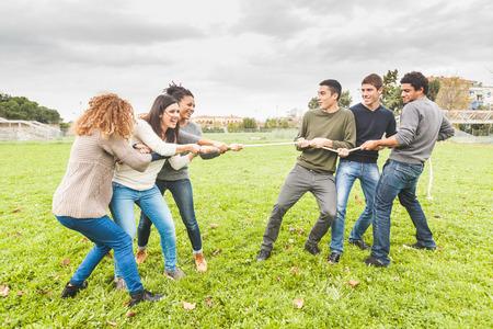 Multiracial People Playing Tug of War
