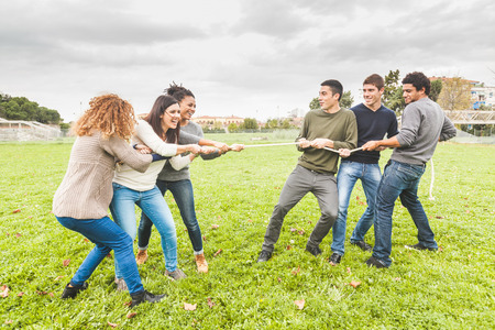 Multiracial People Playing Tug of War