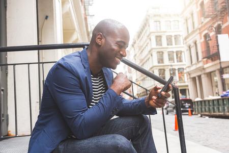 Black Guy Using Smart Phone Stock Photo