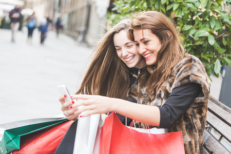 Happy Women with Smart Phone and Shopping Bags Stock fotó
