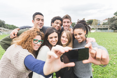 mixed races: Multiethnic Group of Friends Taking Selfie at Park