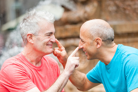 gay men: Gay Couple at Park in New York Stock Photo
