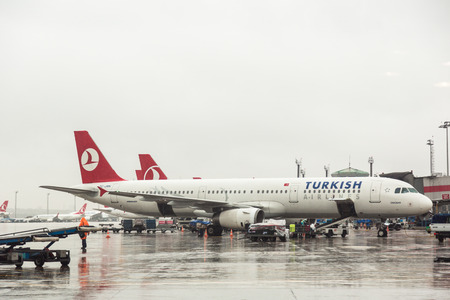 ISTANBUL, TURKEY - OCTOBER 30, 2014: Turkish Airlines airplanes Airbus A321 at Ataturk Airport on a rainy day.