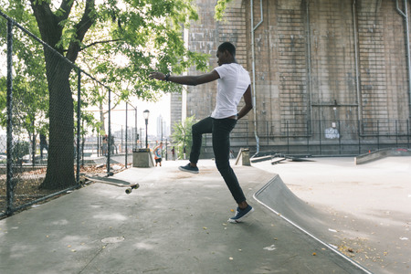 tumble down: Black Boy Skating at Park and Falling Down