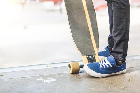 boy skater: Black Boy Skating at Park with Longboard Stock Photo