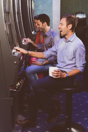 slot machines: Group of Friend Playing with Slot Machines